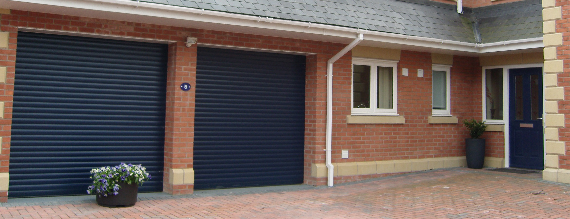 Mg Windows Systems Installers Of Electric Roller Garage Doors In